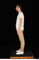 Trent brown trousers casual dressed standing white sneakers white t shirt whole body 0003.jpg